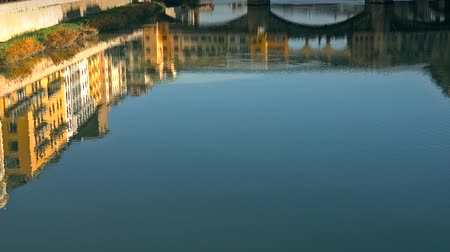 vecchio : Ponte Vecchio bridge and Florentine houses reflection on water, Florence, Italy