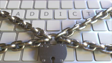 запретить : Padlock and chains on the keyboard with ADDICT text. Conceptual 3D animation