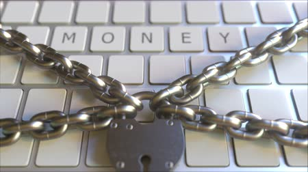 proibir : MONEY word on the keyboard with padlock and chains. Conceptual 3D animation