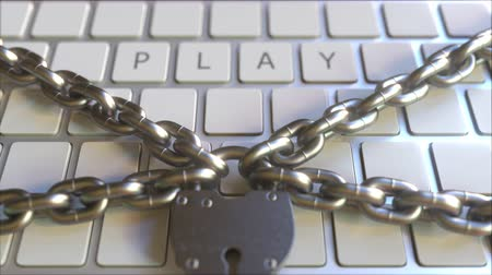 bariéra : Padlock and chains on the keyboard with PLAY text. Conceptual 3D animation