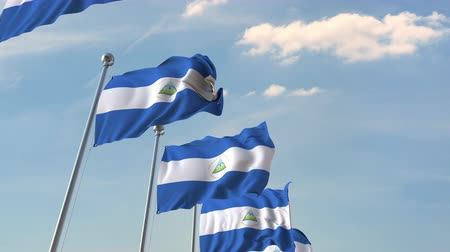 mastro de bandeira : Row of waving flags of Nicaragua. Loopable 3D animation