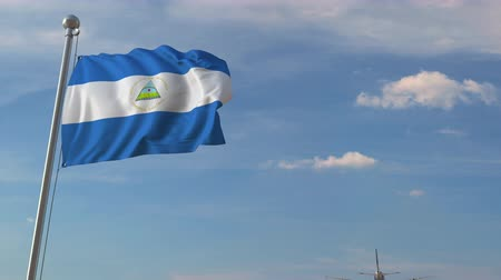 nicaraguan : Commercial airplane flying over national flag of Nicaragua. Nicaraguan air transportation related 3D animation