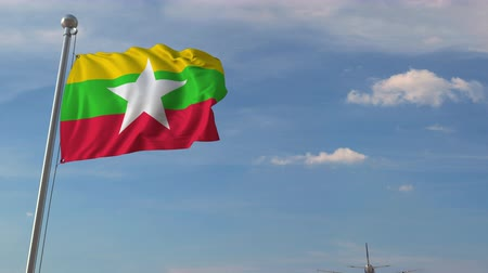 mianmar : Airplane flying over flag of Myanmar. Myanma tourism related 3D animation Stock Footage