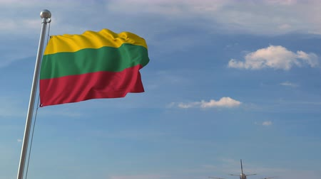 flag of lithuania : Commercial airplane flying over national flag of Lithuania. Lithuanian air transportation related 3D animation