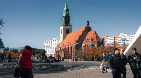 marys : BERLIN, GERMANY - OCTOBER 21, 2018. Marienkirche or St. Marys Church on Alexanderplatz square Stock Footage