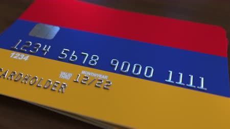 дебет : Plastic bank card featuring flag of Armenia. Armenian national banking system related animation Стоковые видеозаписи