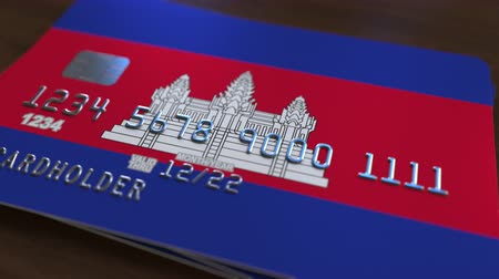 cambojano : Plastic bank card featuring flag of Cambodia. Cambodian national banking system related animation