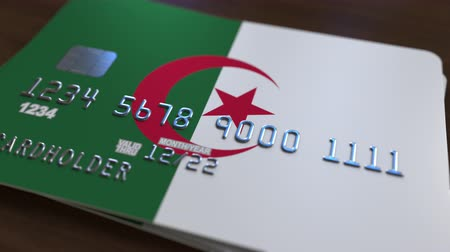 bankomat : Credit card featuring flag of Algeria. Algerian national banking system related animation