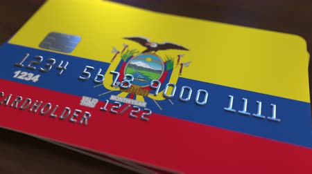 bankomat : Plastic card featuring flag of Ecuador. Ecuadorian national banking system related animation