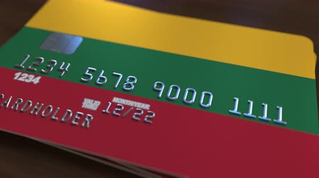 flag of lithuania : Plastic bank card featuring flag of Lithuania. Lithuanian national banking system related animation