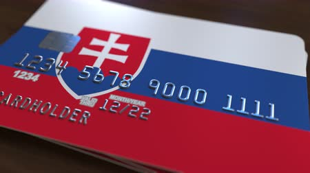 bankomat : Plastic card featuring flag of Slovakia. Slovak national banking system related animation