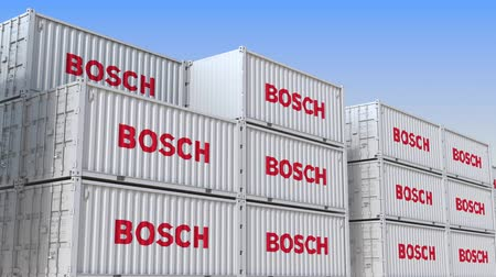 importação : Container yard full of containers with logo of Bosch. Shipment, export or import related loopable editorial 3D animation Vídeos