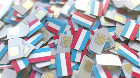 inscrição : Many SIM cards with flag of Luxembourg. Luxembourgian mobile telecommunications related 3D animation