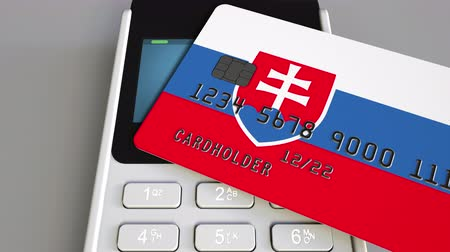 дебет : Plastic card featuring flag of Slovakia and POS payment terminal. Slovak banking system or retail related 3D animation
