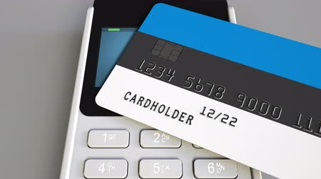 rachunek : Plastic card featuring flag of Estonia and POS payment terminal. Estonian banking system or retail related 3D animation Wideo