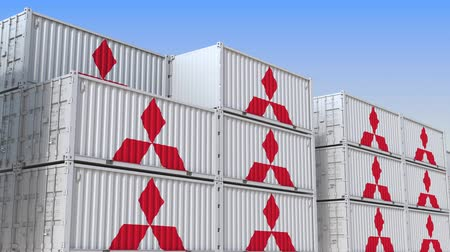 yarda : Container yard full of containers with logo of Mitsubishi. Shipment, export or import related loopable editorial 3D animation Stok Video