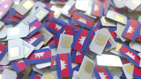abbonamento : Many SIM cards with flag of Cambodia. Cambodian mobile telecommunications related 3D animation