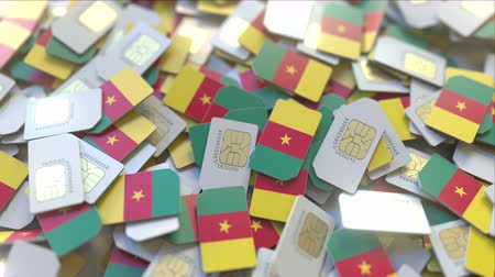 inscrição : Many SIM cards with flag of Cameroon. Cameroonian mobile telecommunications related 3D animation Vídeos