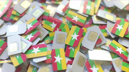 gsm : Many SIM cards with flag of Myanmar. Myanma mobile telecommunications related 3D animation Stock Footage