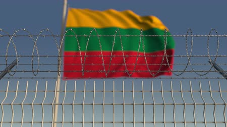 flag of lithuania : Waving flag of Lithuania behind barbed wire fence. Conceptual loopable 3D animation Stock Footage