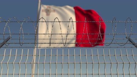 farpado : Flying flag of Malta behind barbed wire fence. Conceptual loopable 3D animation