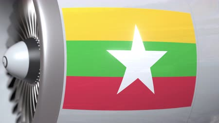mianmar : Waving flag of Myanmar on airplane tourbine engine. Aviation related 3D animation