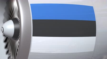estland : Waving flag of Estonia on airplane tourbine engine. Aviation related 3D animation