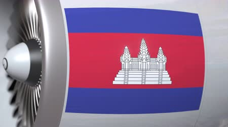 kamboçyalı : Many waving flag of Cambodia on airplane tourbine engine. Aviation related 3D animation