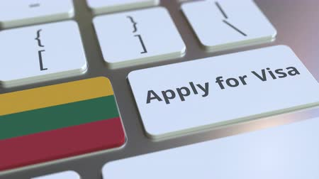 flag of lithuania : APPLY FOR VISA text and flag of Lithuania on the buttons on the computer keyboard. Conceptual 3D animation Stock Footage