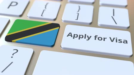 visa : APPLY FOR VISA text and flag of Tanzania on the buttons on the computer keyboard. Conceptual 3D animation