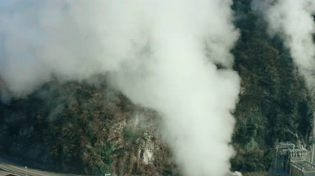 hazardous : Aerial view of rising smoke of air polluting facility