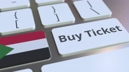 sudanian : BUY TICKET text and flag of Sudan on the buttons on the computer keyboard. Travel related conceptual 3D animation Stock Footage