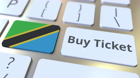 no exterior : BUY TICKET text and flag of Tanzania on the buttons on the computer keyboard. Travel related conceptual 3D animation
