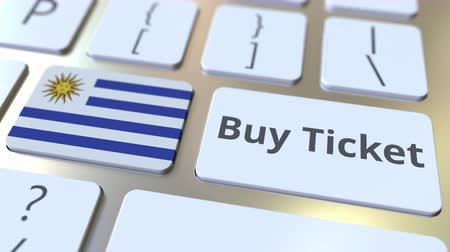 Уругвай : BUY TICKET text and flag of Uruguay on the buttons on the computer keyboard. Travel related conceptual 3D animation Стоковые видеозаписи