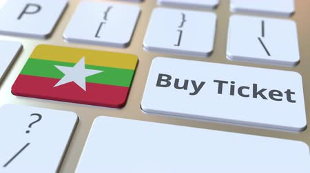 mianmar : BUY TICKET text and flag of Myanmar on the buttons on the computer keyboard. Travel related conceptual 3D animation