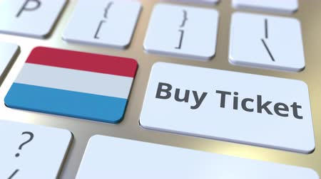 luxemburg : BUY TICKET text and flag of Luxembourg on the buttons on the computer keyboard. Travel related conceptual 3D animation