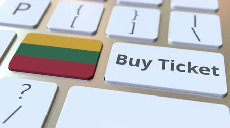 flag of lithuania : BUY TICKET text and flag of Lithuania on the buttons on the computer keyboard. Travel related conceptual 3D animation Stock Footage