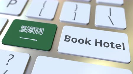 no exterior : BOOK HOTEL text and flag of Saudi Arabia on the buttons on the computer keyboard. Travel related conceptual 3D animation