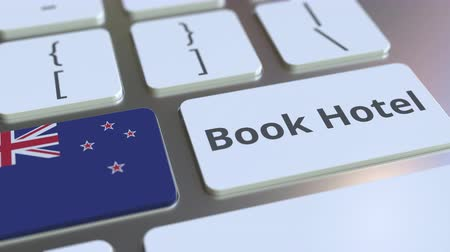 nowa zelandia : BOOK HOTEL text and flag of New Zealand on the buttons on the computer keyboard. Travel related conceptual 3D animation Wideo