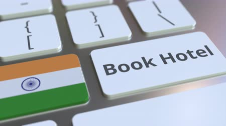 horeca : BOOK HOTEL text and flag of India on the buttons on the computer keyboard. Travel related conceptual 3D animation