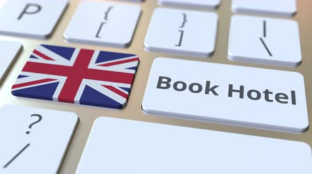 horeca : BOOK HOTEL text and flag of Great Britain on the buttons on the computer keyboard. Travel related conceptual 3D animation