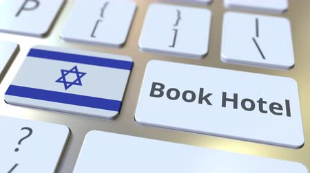 еврей : BOOK HOTEL text and flag of Israel on the buttons on the computer keyboard. Travel related conceptual 3D animation