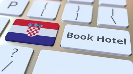 hırvat : BOOK HOTEL text and flag of Croatia on the buttons on the computer keyboard. Travel related conceptual 3D animation