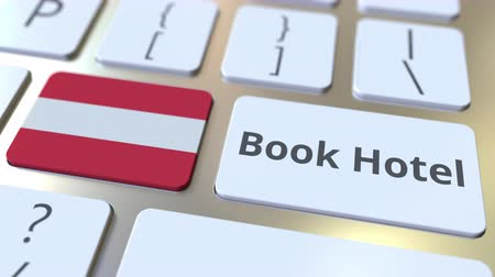 horeca : BOOK HOTEL text and flag of Austria on the buttons on the computer keyboard. Travel related conceptual 3D animation Stock Footage