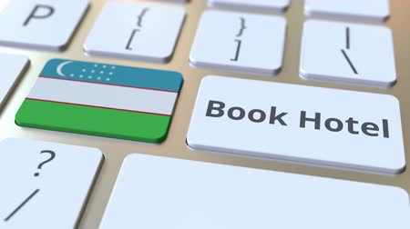 oezbekistan : BOOK HOTEL text and flag of Uzbekistan on the buttons on the computer keyboard. Travel related conceptual 3D animation