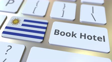convidado : BOOK HOTEL text and flag of Uruguay on the buttons on the computer keyboard. Travel related conceptual 3D animation