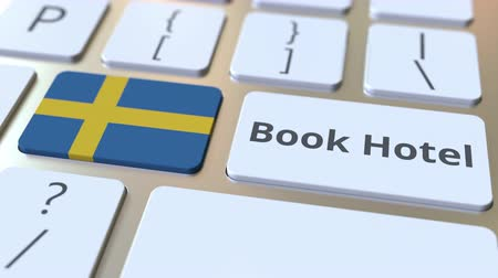 weboldal : BOOK HOTEL text and flag of Sweden on the buttons on the computer keyboard. Travel related conceptual 3D animation