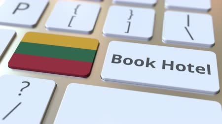 flag of lithuania : BOOK HOTEL text and flag of Lithuania on the buttons on the computer keyboard. Travel related conceptual 3D animation