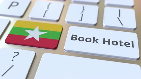 mianmar : BOOK HOTEL text and flag of Myanmar on the buttons on the computer keyboard. Travel related conceptual 3D animation Stock Footage