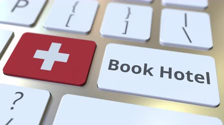 svájc : BOOK HOTEL text and flag of Switzerland on the buttons on the computer keyboard. Travel related conceptual 3D animation Stock mozgókép